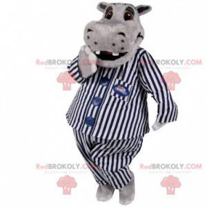 Graues Nilpferdmaskottchen im Pyjama. Maskottchen im Pyjama -