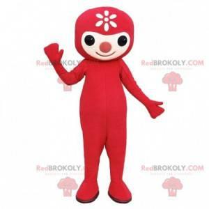 Rotes Schneemannmaskottchen mit einer Blume auf seinem Kopf -