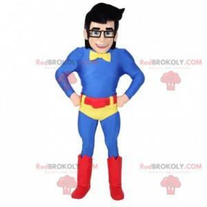 Maskot superhrdiny s brýlemi a barevným oblečením -