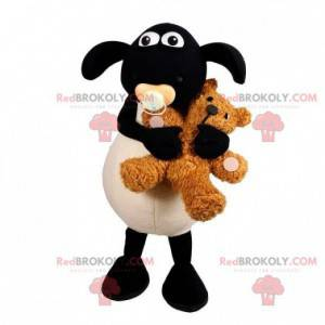 Black and white lamb mascot with a pacifier in the mouth -