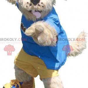 Béžový psí maskot ve žlutém a modrém oblečení - Redbrokoly.com