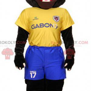 Black tiger mascot in yellow and blue sportswear -