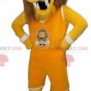 Żółta i brązowa maskotka lwa tygrysa w odzieży sportowej -