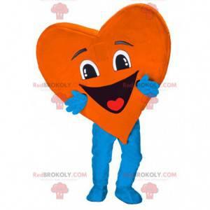 Mascota en forma de corazón muy sonriente. Mascota del corazón