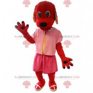 Maskot červený pes oblečený v růžové barvě. Kostým pro psa -