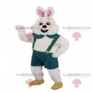 Biały królik maskotka z zielonym kombinezonem. Kostium
