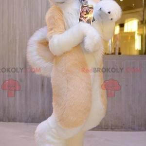 Velmi chlupatý oranžový bílý a šedý psí maskot - Redbrokoly.com
