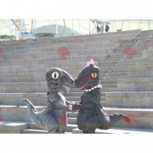 2 maskoti ve stylu gepardů se skvrnitými dinosaury -