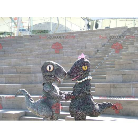 2 cheetah-style spotted couple dinosaur mascots - Redbrokoly.com