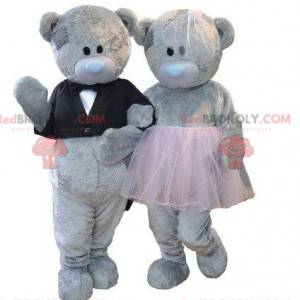 2 gray teddy bear mascots, bear costumes, teddy bear couple -