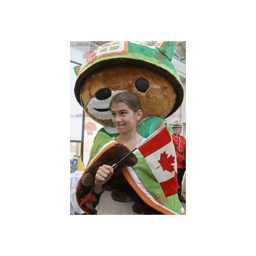 Maskot medvěd hnědý s pláštěm a zelenou helmou - Redbrokoly.com