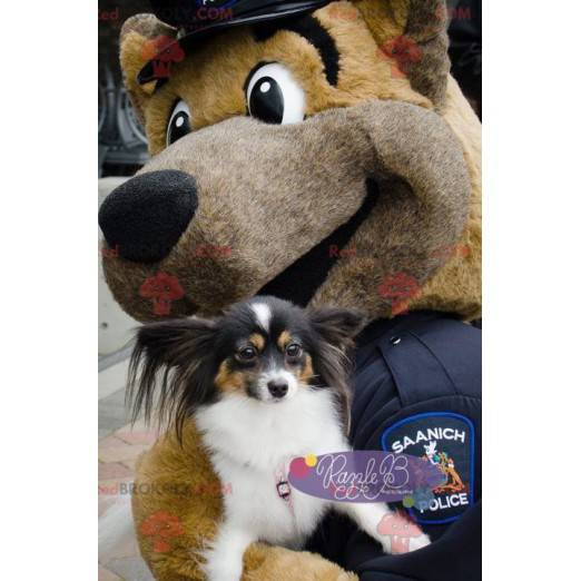 Braunes Hundemaskottchen als Polizist verkleidet -