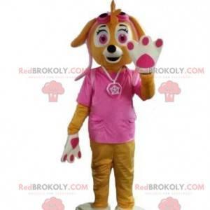 Brązowy pies maskotka, suka ubrana na różowo - Redbrokoly.com