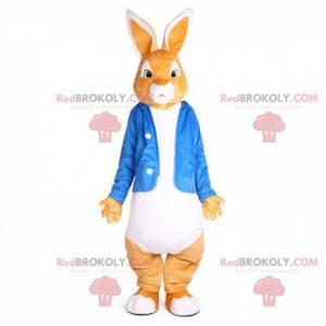 Orange und weißes Kaninchenmaskottchen mit blauer Jacke -