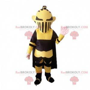 Černá a žlutá robot maskot připomínající Darth Vader -