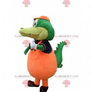 Zelený krokodýlí maskot oblečený v oranžovém aligátorském