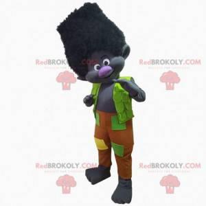 Černý trol maskot oblečený v barevném oblečení, černé stvoření