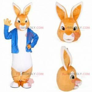 Oransje og hvit kaninmaskot med en blå jakke - Redbrokoly.com