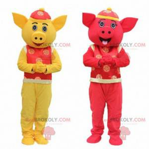 2 mascots of yellow and red pigs, Asian mascots - Redbrokoly.com