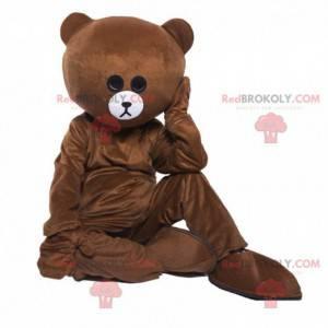 Braunes Teddybärmaskottchen, das traurig aussieht, Bärenkostüm
