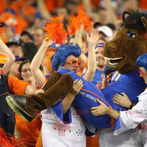 Brown horse mascot in blue outfit - Redbrokoly.com