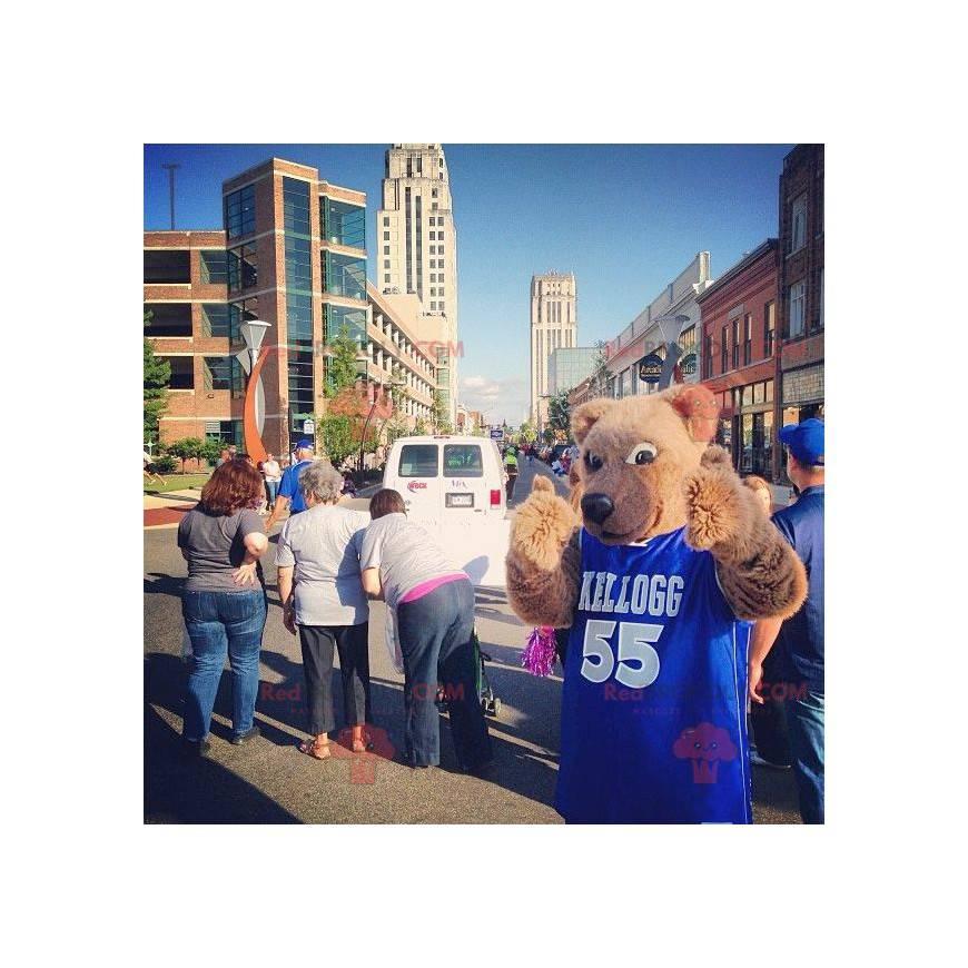 Maskot béžový medvěd s modrým dresem - Redbrokoly.com