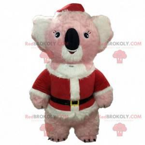 Růžový a bílý maskot koala oblečený jako Santa Claus -