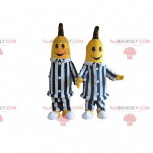 2 banana mascots in black and white striped clothes -