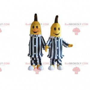 2 Bananenmaskottchen in schwarz-weiß gestreiften Kleidern -