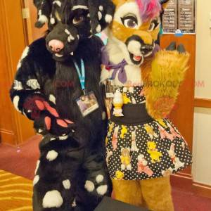 2 mascots of colorful yellow and black dogs - Redbrokoly.com
