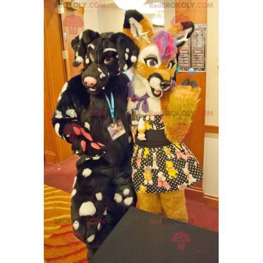 2 Maskottchen mit bunten gelben und schwarzen Hunden -