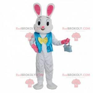 Weißes und rosa Kaninchenmaskottchen mit einer blauen Weste -